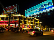 "13 FEBRUARY 2019 - SIHANOUKVILLE, CAMBODIA:  The Golden Pearl Slot, a Chinese owned casino in Sihanoukville. There are about 80 Chinese casinos and resort hotels open in Sihanoukville and dozens more under construction. The casinos are changing the city, once a sleepy port on Southeast Asia's ""backpacker trail"" into a booming city. The change is coming with a cost though. Many Cambodian residents of Sihanoukville  have lost their homes to make way for the casinos and the jobs are going to Chinese workers, brought in to build casinos and work in the casinos.      PHOTO BY JACK KURTZ"
