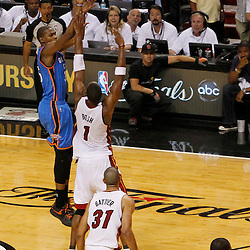 Jun 19, 2012; Miami, FL, USA; Oklahoma City Thunder small forward Kevin Durant (35) shoots a three point shot against Miami Heat power forward Chris Bosh (1) during the fourth quarter in game four in the 2012 NBA Finals at the American Airlines Arena. Miami won 104-98. Mandatory Credit: Derick E. Hingle-US PRESSWIRE