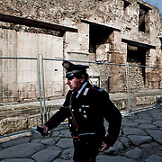 Carabinieri an italian Police during an inspection in Pompeii on february 8 , 2011.Nearly 4 month after the collapse of the House of the Gladiators and then of a wall at the House of the Moralist, Pompeii still faces neglet and mismanagement.Now the Italian government has begun to investigate the matter. Nine people are to be questioned, although Marcello Fiori, the emergency commissioner who was appointed to save the site in 2008, is conspicuously absent from the group.Those who will be grilled by the public prosecutor include the former superintendent of Naples and Pompeii, the site director who oversaw the waterproofing of the House of the Gladiators, the head of technical services at Pompeii, and an architect. The investigation will also examine Fiori's administration, which ended in July, including its use of government funds, which many critics have seen as wasteful and ineffective.