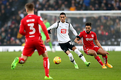 Thomas Ince of Derby County is marshalled by Scott Golbourne of Bristol City - Mandatory by-line: Robbie Stephenson/JMP - 11/02/2017 - FOOTBALL - iPro Stadium - Derby, England - Derby County v Bristol City - Sky Bet Championship