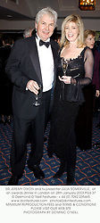 SIR JEREMY DIXON and tv presenter JULIA SOMERVILLE,  at an awards dinner in London on 28th January 2003.	PGS 37