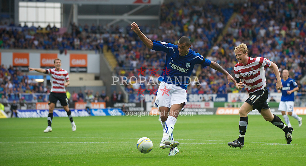 CARDIFF, ENGLAND - Saturday, August 21, 2010: Cardiff City's Jay Bothroyd scores the opening goal against Doncaster Rovers during the Football League Championship match at the Cardiff City Stadium. (Pic by: David Rawcliffe/Propaganda)