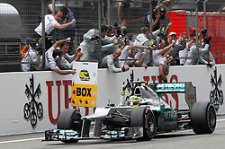 epa03183321 German Formula One driver Nico Rosberg of Mercedes AMG celebrates as he passes before his mechanics after winning the 2012 China Formula One Grand Prix at the Shanghai International circuit in Shanghai, China, 15 April 2012. Rosberg won his first ever F1 Grand Prix ahead of British Formula One drivers Jenson Button and Lewis Hamilton of McLaren Mercedes.  EPA/HOW HWEE YOUNG