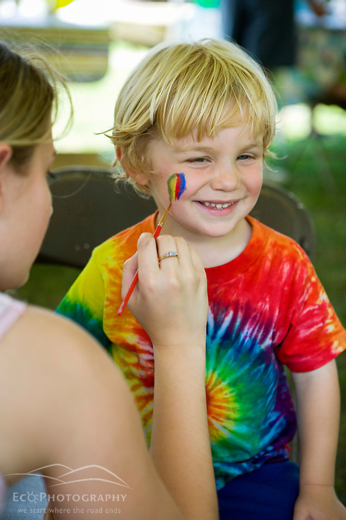 A young boy gets his face painted at the Quechee Balloon Festival Vermont USA (MR)