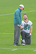Philadelphia Eagles' former offensive coordinator, Pat Shurmur talks to Conner Barwin during his first practice as interim head coach after the firing of Chip Kelly on Wednesday 30 December 2015 at the Nova Care Center in Philadelphia, Pa. . Photograph  by Jim Graham