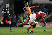 Oliver Burke (Nottingham Forest) goes down after a challenge in the box with Andy Davies (referee) watching intently. No foul given during the Sky Bet Championship match between Hull City and Nottingham Forest at the KC Stadium, Kingston upon Hull, England on 15 March 2016. Photo by Mark P Doherty.