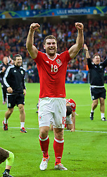 LILLE, FRANCE - Friday, July 1, 2016: Wales' goal-scorer Sam Vokes celebrates after 3-1 victory over Belgium and reaching the Semi-Final during the UEFA Euro 2016 Championship Quarter-Final match at the Stade Pierre Mauroy. (Pic by David Rawcliffe/Propaganda)