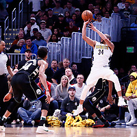 01 April 2018: Denver Nuggets guard Devin Harris (34) takes a jump shot over Milwaukee Bucks forward Giannis Antetokounmpo (34) during the Denver Nuggets 128-125 victory over the Milwaukee Bucks, at the Pepsi Center, Denver, Colorado, USA.