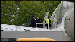 Police officers clear a Pakistan International Airlines plane which was escorted into land by RAF Typhoon jets into Stansted Airport, Essex, as police arrest two men on suspicion of endangerment of an aircraft. Friday, 24th May 2013.Picture by Andrew Parsons / i-Images