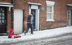 © Licensed to London News Pictures 18/01/2013.  Kenilworth, Warwickshire.   As schools and colleges are closed for the day people make the most of the snow and head out to the local park in Kenilworth this morning.  The weekend is expected to bring continuing snow fall across many parts of the UK.  Photo credit : Alison Baskerville/LNP