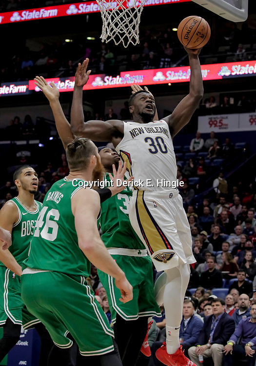 Nov 26, 2018; New Orleans, LA, USA; New Orleans Pelicans forward Julius Randle (30) shoots over Boston Celtics guard Marcus Smart (36) and center Aron Baynes (46) during the first quarter at the Smoothie King Center. Mandatory Credit: Derick E. Hingle-USA TODAY Sports