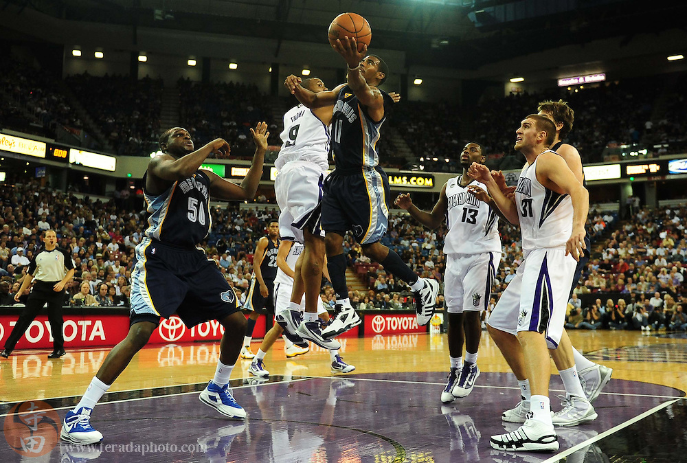 November 2, 2009; Sacramento, CA, USA; Memphis Grizzlies guard Mike Conley (11) drives to the basket during the second quarter against the Sacramento Kings at Arco Arena. The Kings defeated the Grizzlies 127-116 in overtime. Mandatory Credit: Kyle Terada-Terada Photo