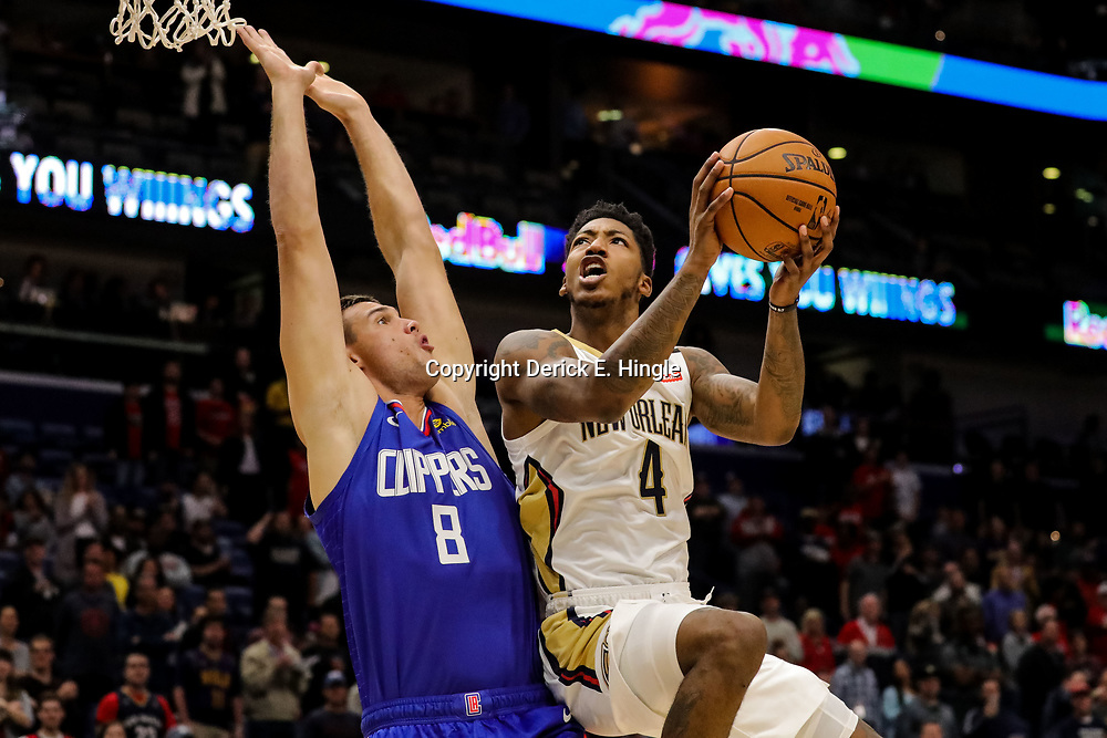 Oct 23, 2018; New Orleans, LA, USA; New Orleans Pelicans guard Elfrid Payton (4) shoots over Los Angeles Clippers forward Danilo Gallinari (8) during the first quarter at the Smoothie King Center. Mandatory Credit: Derick E. Hingle-USA TODAY Sports