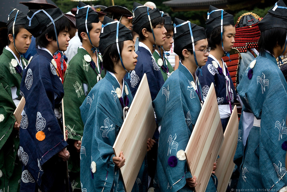 Young people in traditional costumes carrying targets for Yabusame (horse-riding archery shinto ritual), on the 3rd day of the 3-day anual festival of Tsurugaoka Hachimangu shrine in Kamakura.