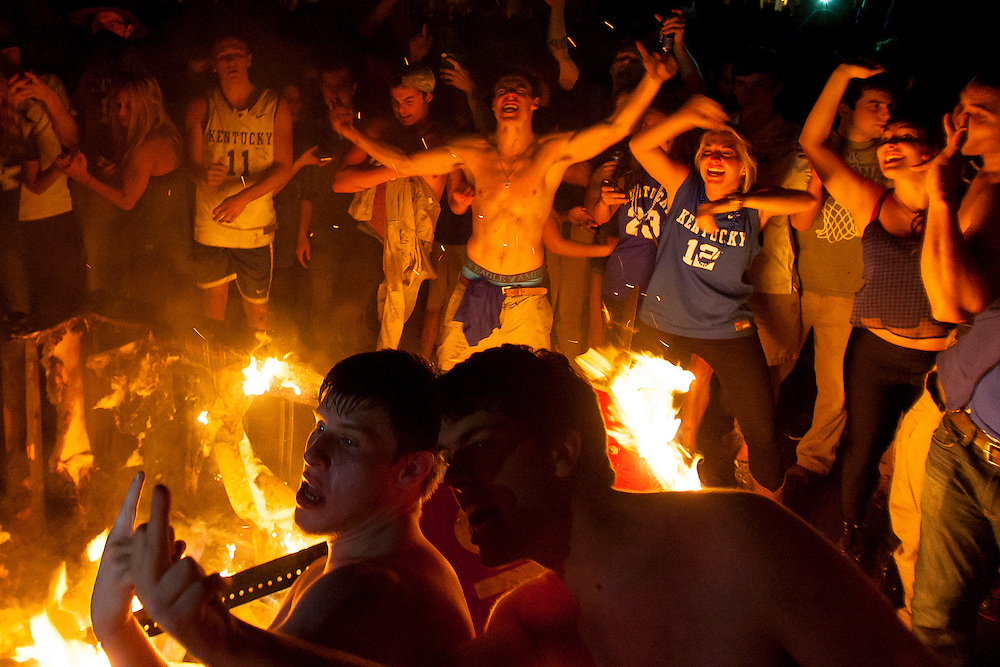 University of Kentucky students dance around a burning couch after Kentucky's win over Louisville in the NCAA Sweet 16.