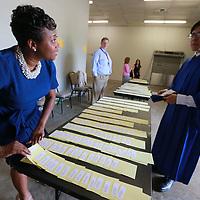 Tupelo High School ninth gradee english teacher Teirney Porter begins chekcing in seniors before their graduation Friday night.