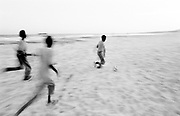 February 1995, Somalia, Merka, kids play football on the sea shore, sand © ISABELLA BALENA www.isabellabalena.com