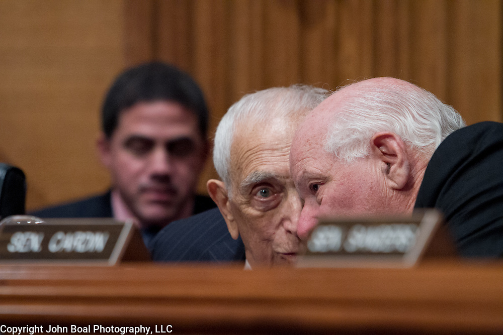 Sen. Frank Lautenberg (D-NJ), left, and Sen. Ben Cardin (D-MD) have a few words during a hearing to vote for an Obama administration nominee on Thursday, May 16, 2013.  Sen. Lautenberg (D-NJ), returned to Washington DC  for the first time since February 28, as weakness in his legs has prevented him from traveling to the Capitol.He died only a few weeks later, on June 3, 2013. John Boal Photography