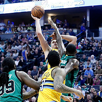 10 March 2017: Denver Nuggets forward Nikola Jokic (15) goes for the baby hood over Boston Celtics forward Amir Johnson (90) during the Denver Nuggets 119-99 victory over the Boston Celtics, at the Pepsi Center, Denver, Colorado, USA.