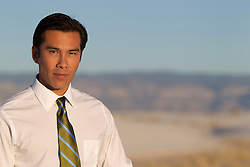 Asian American man wearing a shirt and tie outdoors