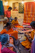 A group of Indian women in a Fabric store Varanasi, India