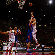 27 February 2018: San Diego State men's basketball hosts Boise State in their last meet up of the regular season at Viejas Arena. San Diego State Aztecs forward Nolan Narain (24) throws up a hook shot over a Boise State defender in the second half. The Aztecs beat the Broncos 72-64.  <br /> More game action at sdsuaztecphotos.com