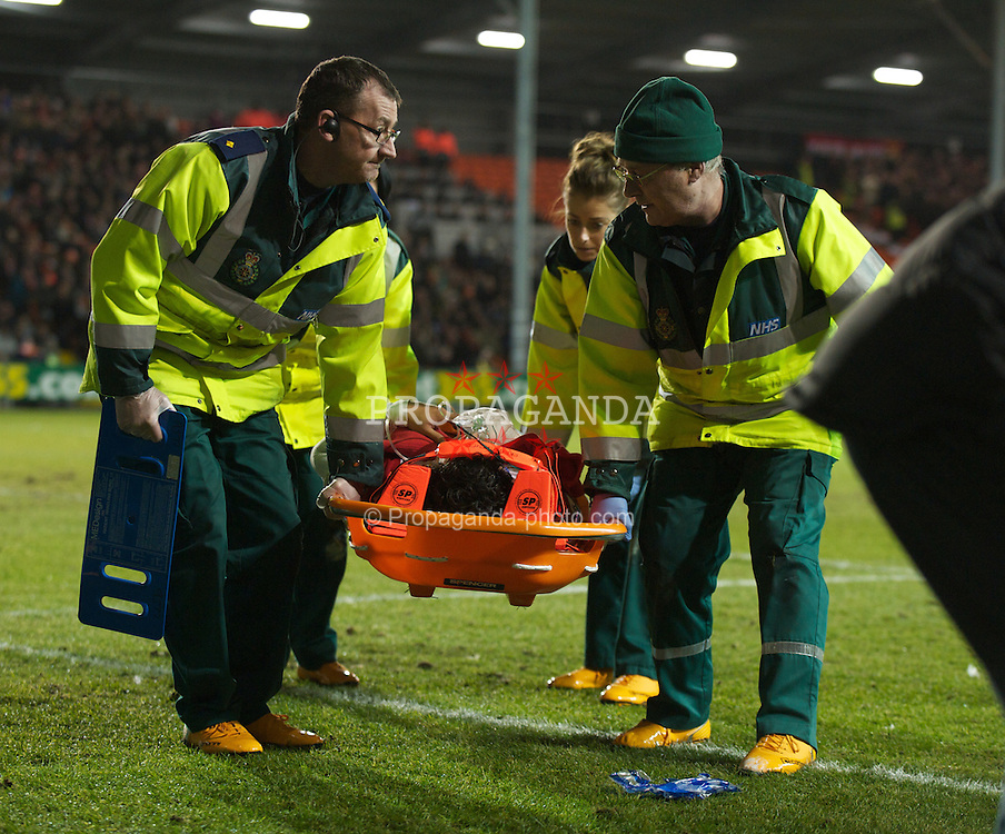 BLACKPOOL, ENGLAND - Tuesday, January 25, 2011: Manchester United's Rafael Da Silva is carried off injured during the Premiership match against Blackpool at Bloomfield Road. (Photo by David Rawcliffe/Propaganda)