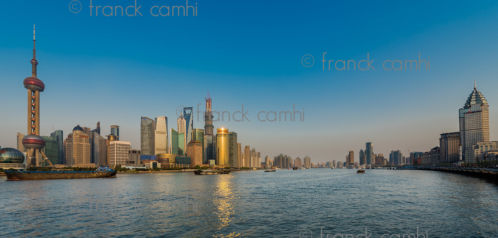 Shanghai, China - April 7, 2013: pudong and the bund on hangpu river Shanghai China at the city of Shanghai in China on april 7th, 2013