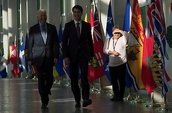 A woman watches as United States Vice-President Joe Biden and Canadian Prime Minister Justin Trudeau walk to a meeting at the First Ministers and National Indigenous Leaders meeting in Ottawa, Friday December 9, 2016. Photo by Adrian Wyld/ The Canadian Press/ABACAPRESS.COM