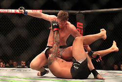 Fabricio Werdum (bottom) and Alexander Volkov in action during their Heavyweight fight at The O2 Arena, London.