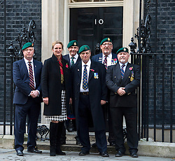 © Licensed to London News Pictures. 28/10/2015. London, UK. CLAIRE BLACKMAN, wife of Sgt Alexander Blackman, joined by former servicemen as she hands in a letter to 10 Downing Street requesting the release of her husband from prison where he is serving a life sentence after being convicted of murdering a wounded Taliban fighter.  Photo credit: Ben Cawthra/LNP