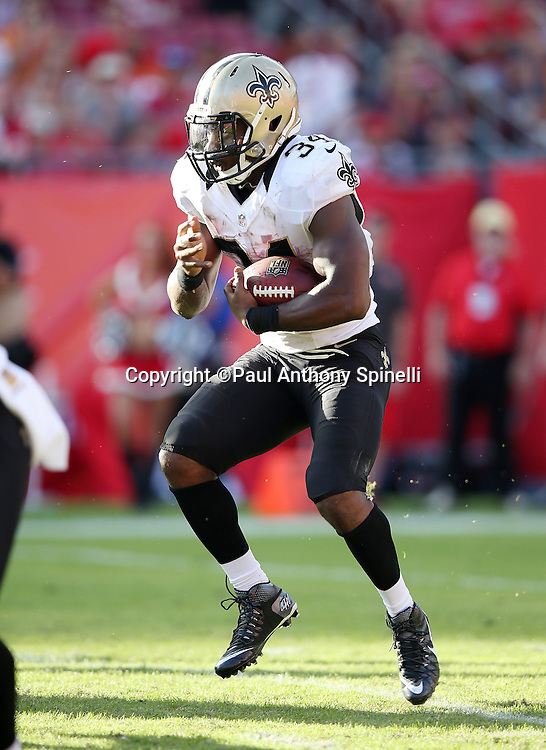 New Orleans Saints running back Tim Hightower (34) runs the ball in the fourth quarter during the 2015 week 14 regular season NFL football game against the Tampa Bay Buccaneers on Sunday, Dec. 13, 2015 in Tampa, Fla. The Saints won the game 24-17. (©Paul Anthony Spinelli)
