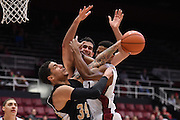 November 14, 2014; Stanford, CA, USA; Wofford Terriers forward Lee Skinner (34) fights for the rebound against Stanford Cardinal center Stefan Nastic (4, center) and guard/forward Anthony Brown (21, right) during the second half at Maples Pavilion.
