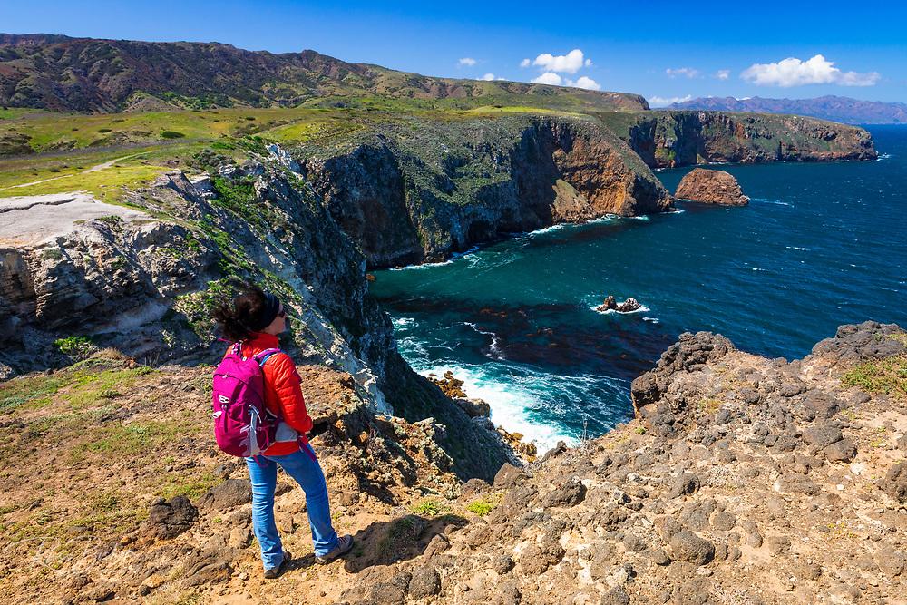 Hiker enjoying the view from Cavern Point, Santa Cruz Island, Channel Islands National Park, California USA