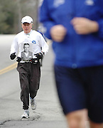 In honor of his brother Kevin, Joseph Renaghan, 63, from Glenn Cove, NY, runs the 21-mile practice run for the Boston Marathon in Hopkinton, MA. Kevin died from a rare brain tumor in 1978 after exposure to Agent Orange early in the Vietnam War...Photo by Isabel Slepoy