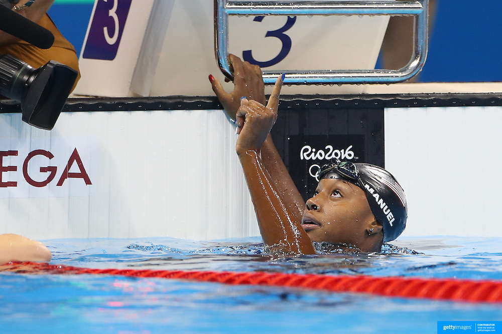 Swimming - Olympics: Day 6   Simone Manuel of the United States winning the Women's 100m Freestyle Final during the swimming competition at the Olympic Aquatics Stadium August 11, 2016 in Rio de Janeiro, Brazil. (Photo by Tim Clayton/Corbis via Getty Images)