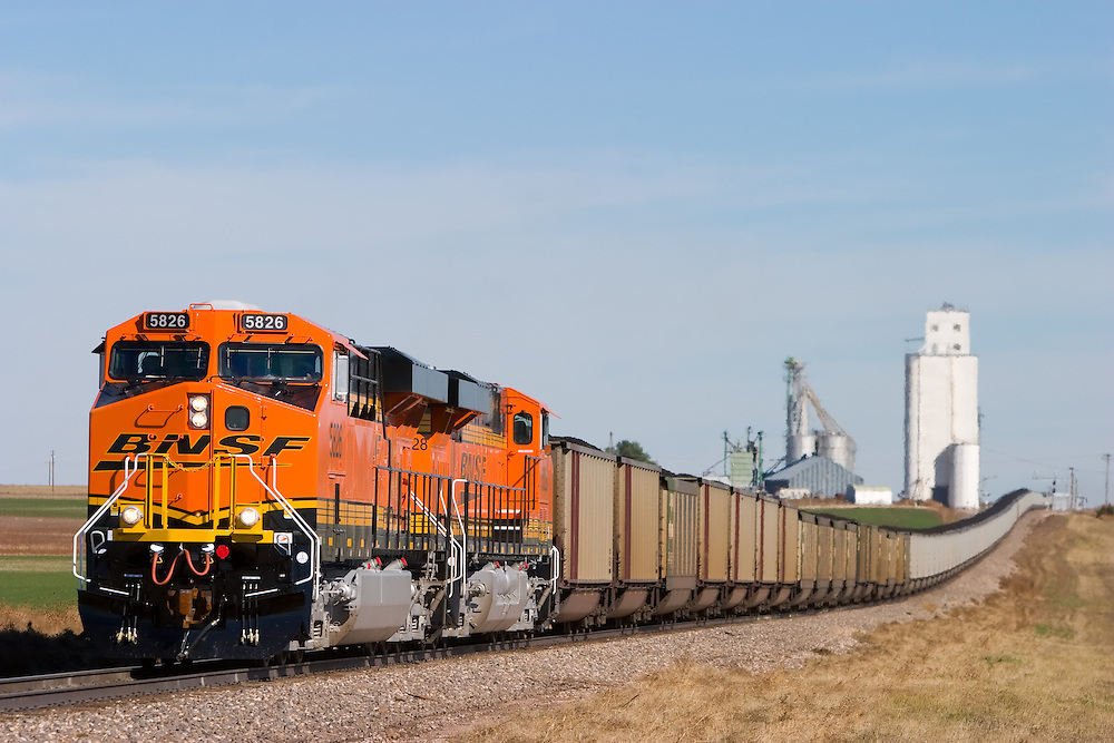 Climbing out of a sag in the track, a southbound BNSF loaded coal train speeds over the undulating profile of the Angora Subdivision at the Nebraska/Colorado border south of Sidney, NE.