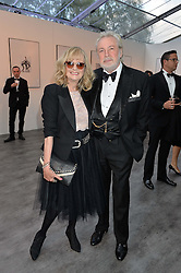 TWIGGY and her husband LEIGH LAWSON at British Vogue's Centenary Gala Dinner in Kensington Gardens, London on 23rd May 2016.