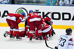 Radek Martinek of Czech Republic lying injured on the ice after hit by Arturs Kulda of Latvia during ice-hockey match between Czech Republic and Latvia of Group D of IIHF 2011 World Championship Slovakia, on April 30, 2011 in Orange Arena, Bratislava, Slovakia. (Photo by Matic Klansek Velej / Sportida)