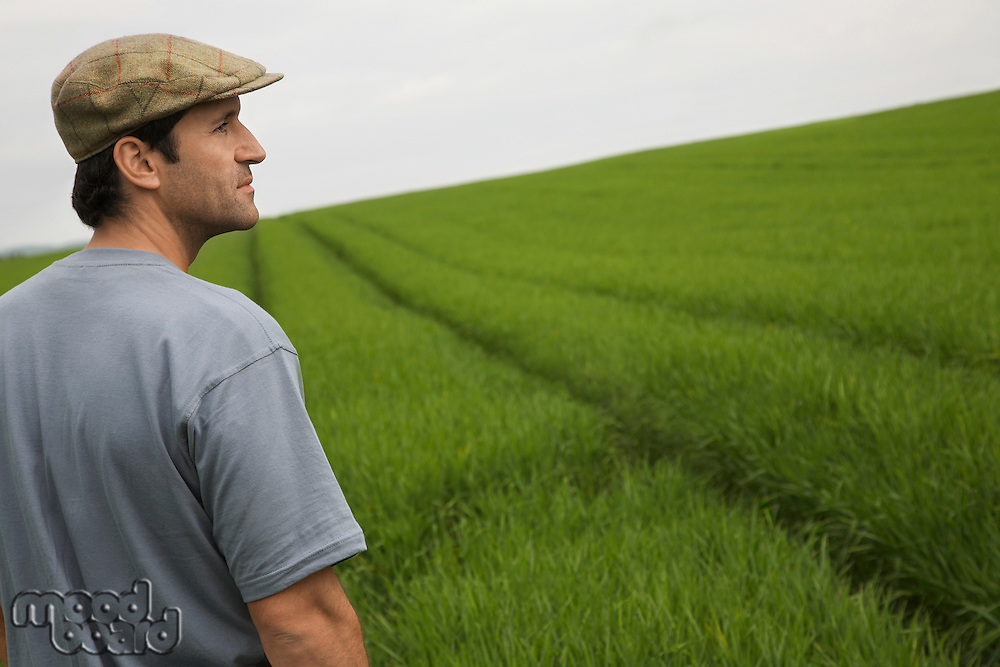 Man standing in field side view