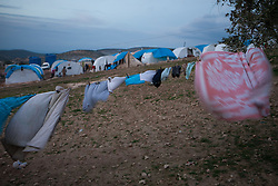 Refugees hanging their clothes on the line between olive tree's on Qah's refugee camp with around 525 tents at sunset. Idlib province, Syria.    Situated 7 km away from the Turkish border Qah refugee camp is one of the three refugee camps in the area -inside Syria's territory- with an estimated number of 3,200 refugees and growing by the day. Build in August 2012 by the help of Libyan al-Yosser charity and with the provision of tents, blankets etc of the Syrian National Council, Syria, February 6, 2013. Photo by Daniel Leal-Olivas / i-Images.