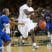 Isaiah Sykes (32) of the University of Central Florida Knights mens basketball team dribbles the ball past the West Florida Argonauts in the first home game of the 2010 season at the UCF Arena on November 12, 2010 in Orlando, Florida. UCF won the game 115-61. (AP Photo/Alex Menendez)