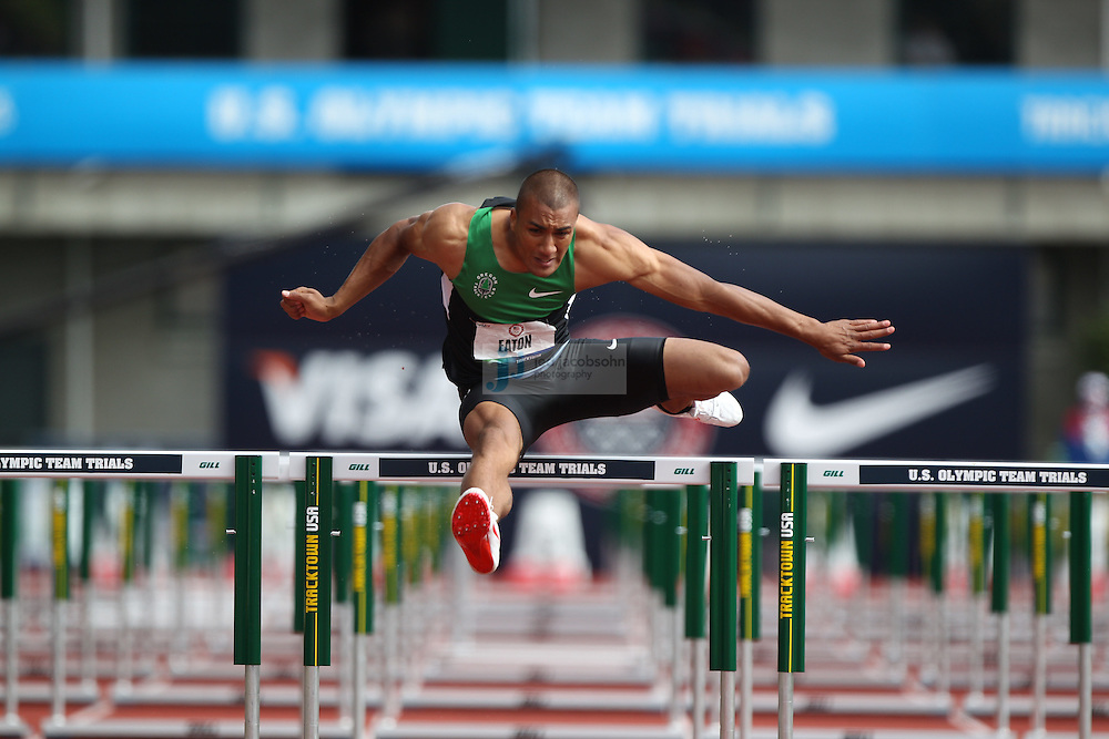 Ashton Eaton races in the 110m hurdles for the Decathlon during day 2 of the U.S. Olympic Trials for Track & Field at Hayward Field in Eugene, Oregon, USA 23 Jun 2012..(Jed Jacobsohn/for The New York Times)....