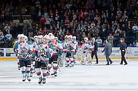 KELOWNA, CANADA - APRIL 25: The Kelowna Rockets skate to shake hands with the Portland Winterhawks on April 25, 2014 during Game 5 of the third round of WHL Playoffs at Prospera Place in Kelowna, British Columbia, Canada. The Portland Winterhawks won 7 - 3 and took the Western Conference Championship for the fourth year in a row earning them a place in the WHL final.  (Photo by Marissa Baecker/Getty Images)  *** Local Caption ***