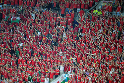 LYON, FRANCE - Wednesday, July 6, 2016: Wales supporters sing the UEFA Euro 2016 Championship Semi-Final match against Portugal at the Stade de Lyon. (Pic by Paul Greenwood/Propaganda)