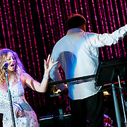 July 13, 2013 - New York, NY : <br /> The New York Philharmonic, lead by Alan Gilbert, standing at right, and accompanied by Mariah Carey, standing at left, perform in the free MLB All-Star Charity Concert to benefit Hurricane Sandy victims, in Central Park's great lawn on July 13, 2013.  **THIS IMAGE IS A CROP VARIATION** <br /> CREDIT: Karsten Moran for The New York Times