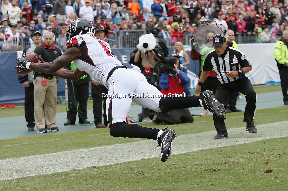 Atlanta Falcons wide receiver Julio Jones (11) dives for and catches an end zone pass for an apparent touchdown ruled out of bounds in the second quarter during the 2015 week 7 regular season NFL football game against the Tennessee Titans on Sunday, Oct. 25, 2015 in Nashville, Tenn. The Falcons won the game 10-7. (©Paul Anthony Spinelli)
