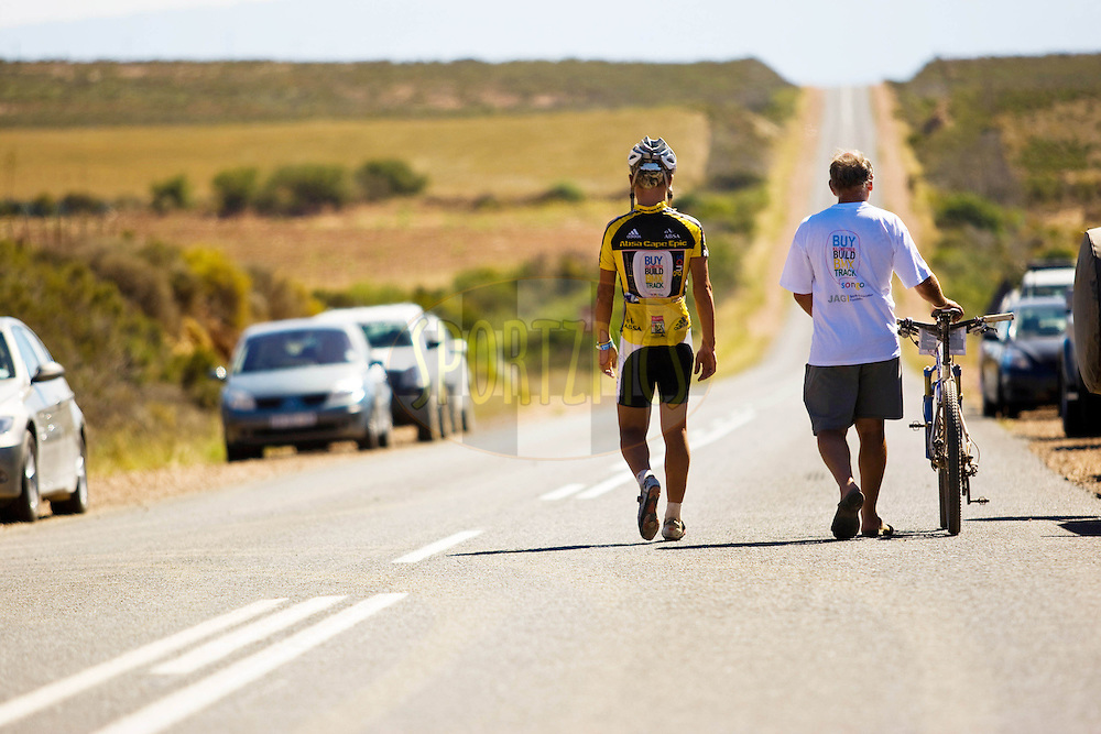 WESTERN CAPE, SOUTH AFRICA -  31 March 2008, Burry Stander, race Leader (Team songo.info) had to withdraw due to a knee injury (ITB) during stage three of the 2008 Absa Cape Epic Mountain Bike stage race from Calitzdorp Spa.to Langenhoven High School in Riversdale, Western Cape, South Africa..Photo by Sven Martin/SPORTZPICS