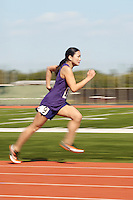 Female athlete running side view