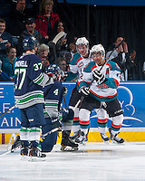 KELOWNA, CANADA - APRIL 3: Cole Linaker #26 and Tyrell Goulbourne #12 of the Kelowna Rockets celebrate a goal against the Seattle Thunderbirds on April 3, 2014 during Game 1 of the second round of WHL Playoffs at Prospera Place in Kelowna, British Columbia, Canada.   (Photo by Marissa Baecker/Getty Images)  *** Local Caption *** Cole Linaker; Tyrell Goulbourne;